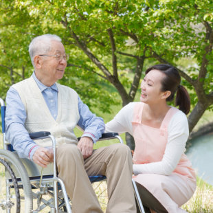 senior man and caregiver looking at each other